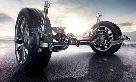 Front MacPherson + rear multi-link suspension